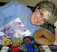 Pamela Zimmerman with awards taken at the 2002 North Carolina Basketmakers Association Convention
